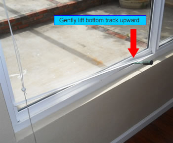 removing bottom track from vinyl window